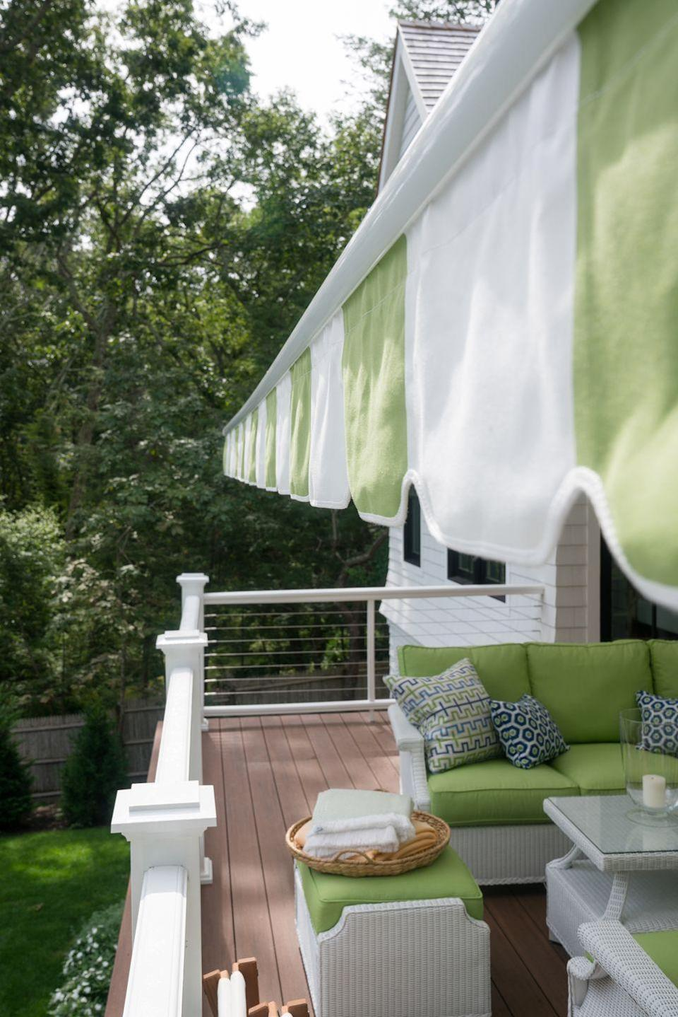 """<p>""""For a finished option, auto-tilt umbrellas are nice because they allow you to adjust the canopy throughout the day,"""" Voorhis says. """"At the same time, a retractable awning can give you a more consistently shaded outdoor office.""""</p>"""