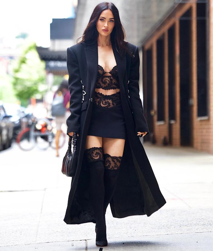 <p>Megan Fox turns heads in a sultry, all-black ensemble on her way to a secret fitting in New York City.</p>