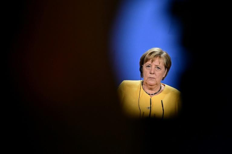 Merkel is about to bow out of politics following an election this month closing the door on her 16 years in power (AFP/Tobias SCHWARZ)