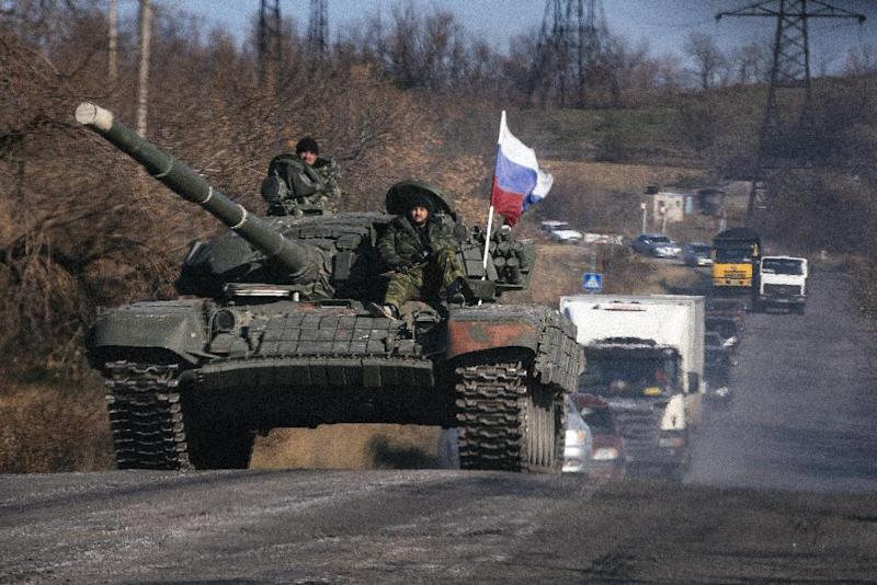 Pro-Russian separatists ride on top of a tank in the Lugansk region of Ukraine on October 28, 2014 (AFP Photo/Dimitar Dilkoff)
