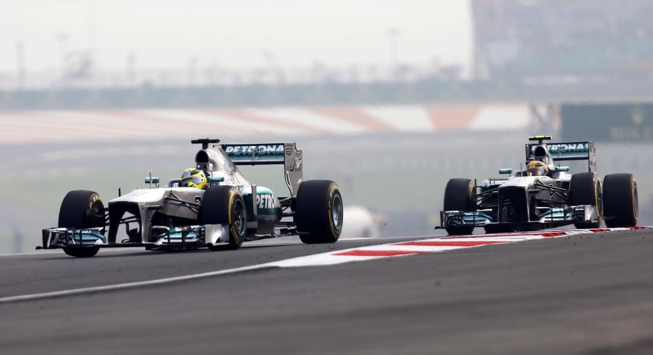 Mercedes Formula One driver Nico Rosberg of Germany (L) and Mercedes Formula One driver Lewis Hamilton of Britain drive during the qualifying session of the Indian F1 Grand Prix at the Buddh International Circuit in Greater Noida, on the outskirts of New Delhi, October 26, 2013. REUTERS/Ahmad Masood (INDIA - Tags: SPORT MOTORSPORT F1)