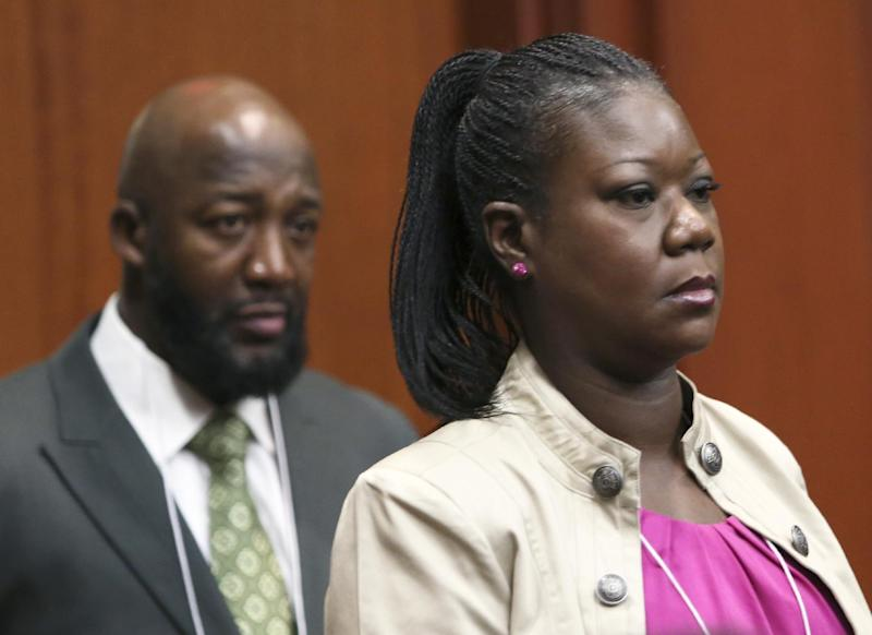 Trayvon Martin's parents, Tracy Martin, left, and Sybrina Fulton, enter the courtroom during George Zimmerman's trial in Seminole County circuit court in Sanford, Fla. Tuesday, June 25, 2013. Zimmerman has been charged with second-degree murder for the 2012 shooting death of Trayvon Martin. (AP Photo/Orlando Sentinel, Gary W. Green, Pool)
