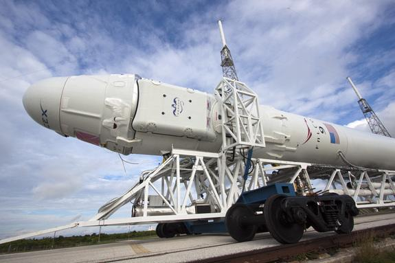In a close-up view, the Space Exploration Technologies Corp., or SpaceX, Falcon 9 rocket with Dragon capsule attached on top begins a rollout demonstration test to Space Launch Complex-40 at Cape Canaveral Air Force Station in Florida. This ima
