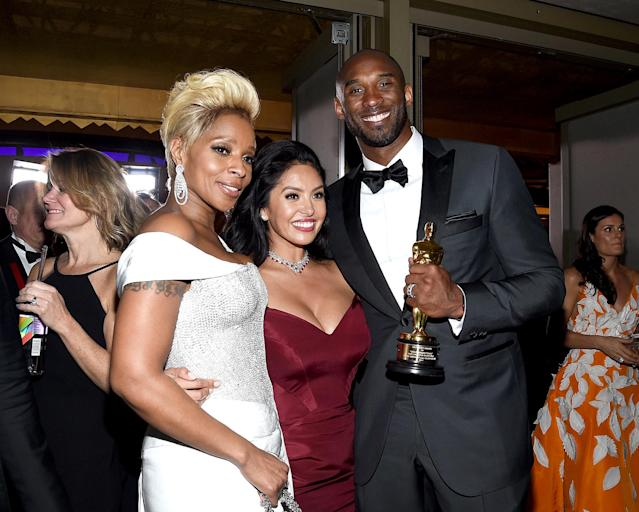 <p>Though she didn't take home an Oscar for Best Supporting Actress, Blige helped Bryant and his wife Vanessa celebrate his big win for Best Animated Short at the Governors Ball. (Photo: Kevork Djansezian/Getty Images) </p>