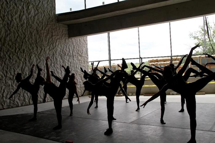 Students from the Duke Ellington School of the Arts perform at the REACH's construction site (AFP Photo/Olivia HAMPTON)