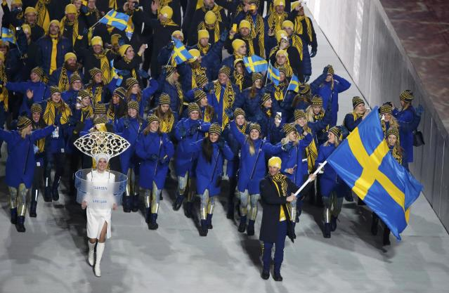 Sweden's flag-bearer Anders Soedergren leads his country's contingent during the athletes' parade at the opening ceremony of the 2014 Sochi Winter Olympics, February 7, 2014. REUTERS/Lucy Nicholson (RUSSIA - Tags: OLYMPICS SPORT)
