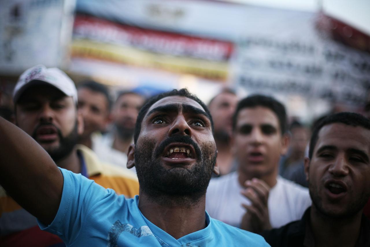 Egyptian protesters shout slogans in Tahrir Square as the country awaits the outcome of a presidential runoff vote in Cairo, Egypt, Saturday, June 23, 2012. Tens of thousands of supporters of the Muslim Brotherhood have rallied in the capital's Tahrir Square in a show of force backing candidate Mohammed Morsi, who has warned against manipulating results in a vote that he says he has won. (AP Photo/Manu Brabo)