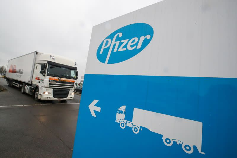 A refrigerated truck leaves the Pfizer plant in Puurs