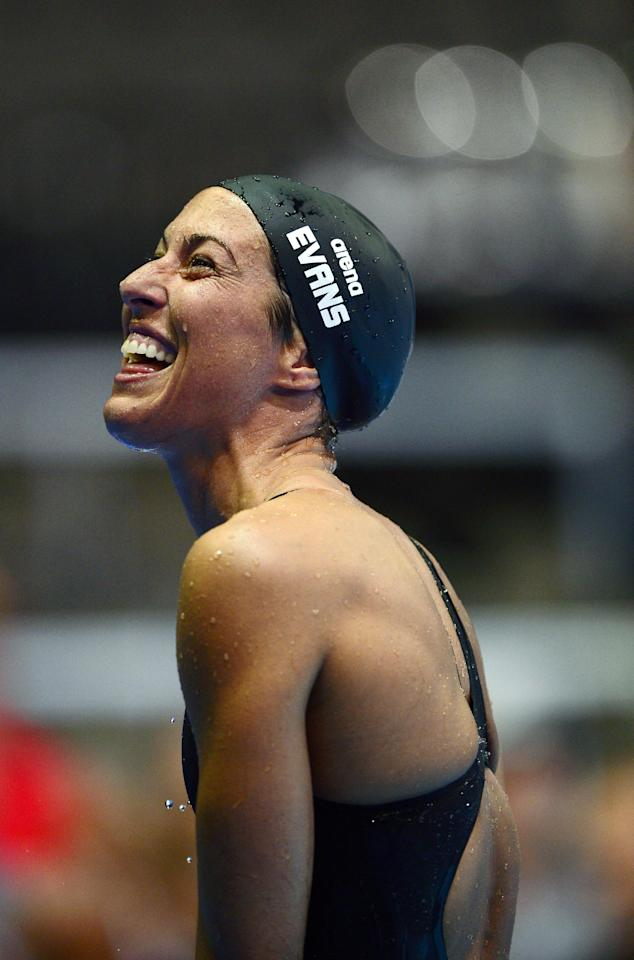 Janet Evans smiles after swimming in the women's 400-meter freestyle preliminaries at the U.S. Olympic swimming trials, Tuesday, June 26, 2012, in Omaha, Neb. (AP Photo/Mark J. Terrill)