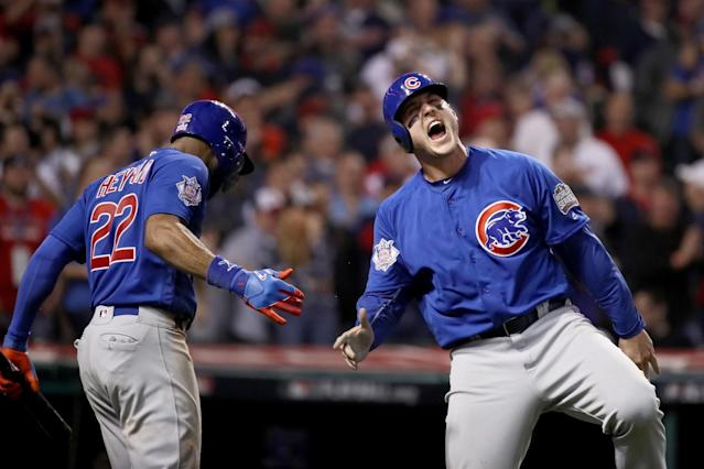 <p>Anthony Rizzo #44 of the Chicago Cubs celebrates with Jason Heyward #22 after Rizzo scores a run in the 10th inning on a Miguel Montero #47 against the Cleveland Indians in Game Seven of the 2016 World Series at Progressive Field on November 2, 2016 in Cleveland, Ohio. (Photo by Ezra Shaw/Getty Images) </p>
