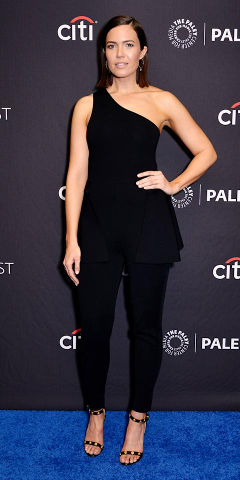 """<p>Mandy Moore proved less can often be more in a black one-shoulder top and tailored pants by <a rel=""""nofollow"""" href=""""https://click.linksynergy.com/deeplink?id=93xLBvPhAeE∣=38359&murl=https%3A%2F%2Fwww.barneys.com%2Fdesigner%2Fstella-mccartney%2FN-2k4hfp&u1=IS,MandyMoore,anesta,,IMA,3433901,201903,I"""">Stella McCartney</a>, <a rel=""""nofollow"""" href=""""https://eriness.com/"""">Eriness</a> jewelry, and Versace heels ($995; <a rel=""""nofollow"""" href=""""https://click.linksynergy.com/deeplink?id=93xLBvPhAeE∣=37508&murl=https%3A%2F%2Fwww.farfetch.com%2Fshopping%2Fwomen%2Fversace-embellished-medusa-sandals-item-12749526.aspx&u1=IS,MandyMoore,anesta,,IMA,3433901,201903,I"""">farfetch.com</a>).</p>"""