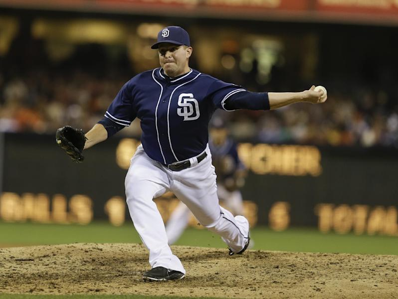 In this July 13, 2013 photo, San Diego Padres pitcher Joe Thatcher throws against the San Francisco Giants in San Diego. The Arizona Diamondbacks have sent struggling right-hander Ian Kennedy to the Padres for Thatcher, a minor leaguer and a draft pick. (AP Photo/Lenny Ignelzi, Fileq)