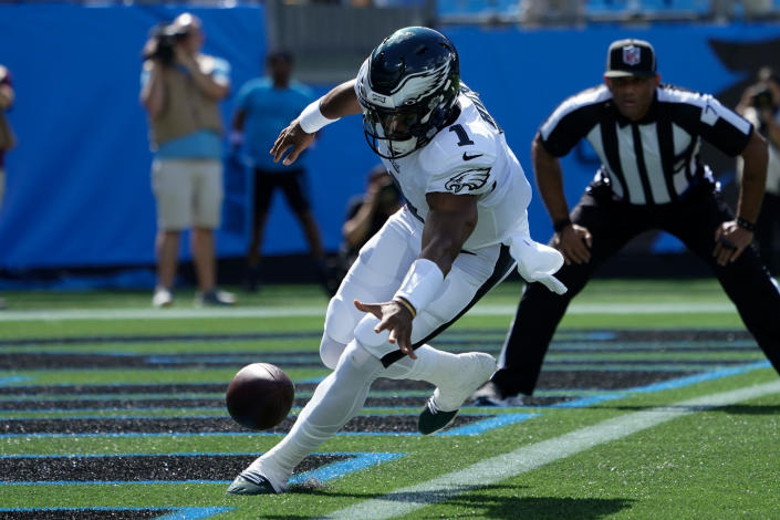 Philadelphia Eagles quarterback Jalen Hurts chases a fumble into the end zone against the Carolina Panthers during the first half of an NFL football game Sunday, Oct. 10, 2021, in Charlotte, N.C. Carolina Panthers defensive back Sean Chandler recovered the ball for a safety. (AP Photo/Jacob Kupferman)
