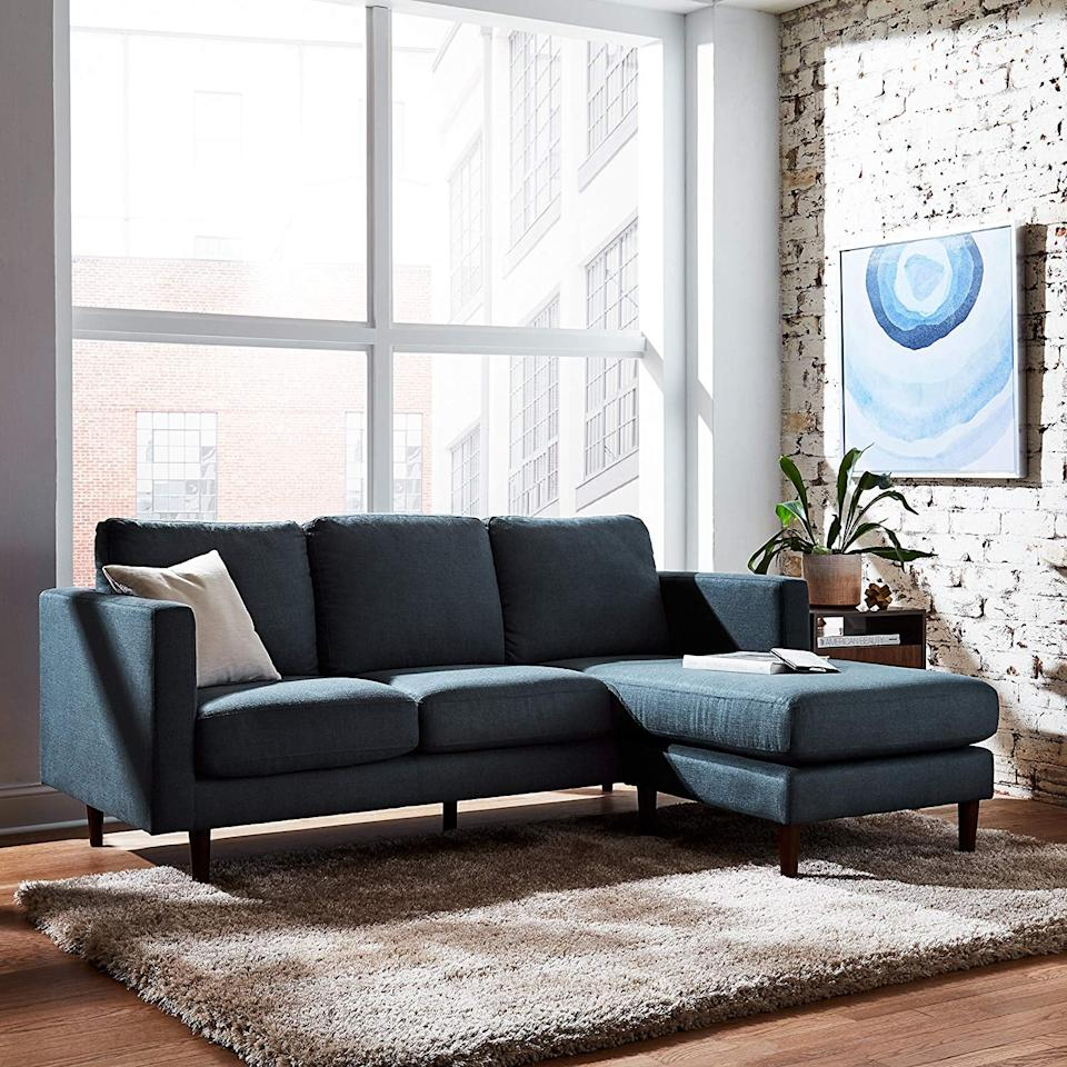 "<p>This luxe <a href=""https://www.popsugar.com/buy/Rivet%20Revolve%20Mid-Century%20Modern%20Reversible%20Chaise%20Sectional%20Sofa-473011?p_name=Rivet%20Revolve%20Mid-Century%20Modern%20Reversible%20Chaise%20Sectional%20Sofa&retailer=amazon.com&price=799&evar1=casa%3Aus&evar9=46426423&evar98=https%3A%2F%2Fwww.popsugar.com%2Fhome%2Fphoto-gallery%2F46426423%2Fimage%2F46426431%2FRivet-Revolve-Mid-Century-Modern-Reversible-Chaise-Sectional-Sofa&list1=shopping%2Cfurniture%2Csofas%2Csmall%20space%20living%2Chome%20shopping&prop13=api&pdata=1"" rel=""nofollow"" data-shoppable-link=""1"" target=""_blank"" class=""ga-track"" data-ga-category=""Related"" data-ga-label=""https://www.amazon.com/Rivet-Revolve-Mid-Century-Reversible-Sectional/dp/B072FVHRZ1/ref=sr_1_1_sspa?crid=3QHYBH9P9Q7H2&amp;keywords=sectional%2Bsofa&amp;qid=1564158415&amp;s=gateway&amp;sprefix=section%2Caps%2C205&amp;sr=8-1-spons&amp;spLa=ZW5jcnlwdGVkUXVhbGlmaWVyPUExTVozWFIxSlRNNTBLJmVuY3J5cHRlZElkPUEwMTY2ODI0WENHOUIzNkNES0lTJmVuY3J5cHRlZEFkSWQ9QTA3MDY5NTEyTlBINlkyTjZHTEVEJndpZGdldE5hbWU9c3BfYXRmJmFjdGlvbj1jbGlja1JlZGlyZWN0JmRvTm90TG9nQ2xpY2s9dHJ1ZQ&amp;th=1"" data-ga-action=""In-Line Links"">Rivet Revolve Mid-Century Modern Reversible Chaise Sectional Sofa</a> ($799) is at the top of our wish list.</p>"