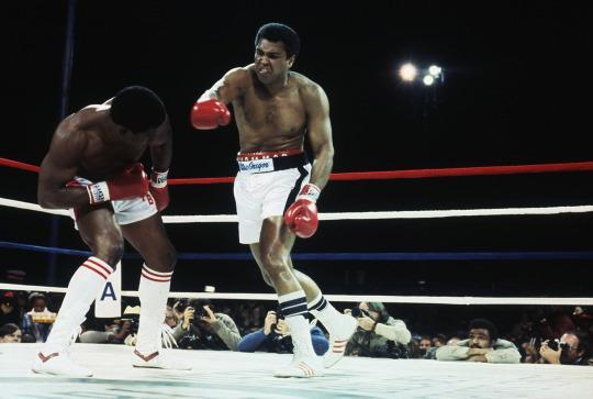 <p>MIAMI BEACH, FL – DECEMBER 11: Muhammad Ali throws a punch against Trevor Berbick who dodges the punch at the Miami Beach Convention Center in Miami Beach on December 11, 1981. Muhammad Ali lost the bout to Trevor Berbick, ending Ali's comeback and entering him permanently into retirement. (Photo by Focus on Sport/Getty Images)</p>