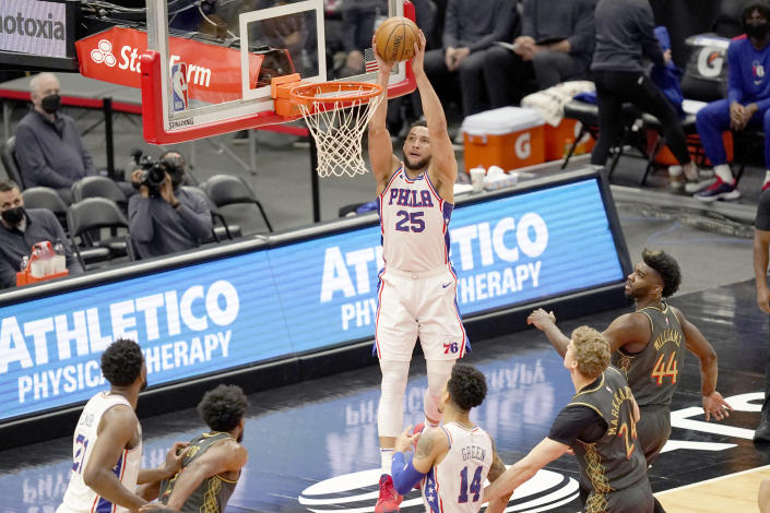 Philadelphia 76ers' Ben Simmons (25) goes up for a dunk during the first half of an NBA basketball game against the Chicago Bulls Monday, May 3, 2021, in Chicago. (AP Photo/Charles Rex Arbogast)