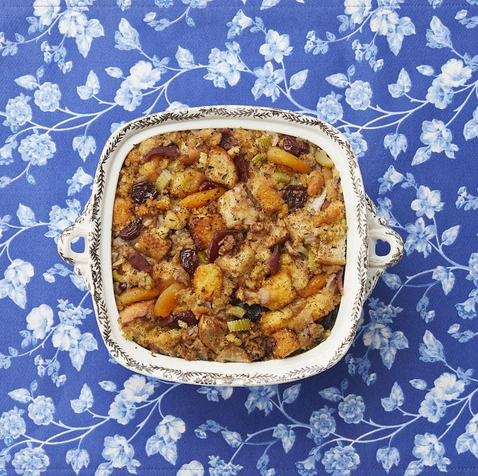 "<p>Get creative in the kitchen with this cornbread dressing that has fruit and nuts mixed in. It'll bring a pop of bold flavor to your table!</p><p><strong><a href=""https://www.thepioneerwoman.com/food-cooking/recipes/a34575852/cornbread-dr"" rel=""nofollow noopener"" target=""_blank"" data-ylk=""slk:Get the recipe."" class=""link rapid-noclick-resp"">Get the recipe.</a></strong></p><p><a class=""link rapid-noclick-resp"" href=""https://go.redirectingat.com?id=74968X1596630&url=https%3A%2F%2Fwww.walmart.com%2Fsearch%2F%3Fquery%3Dpioneer%2Bwoman%2Bbaking%2Bdishes&sref=https%3A%2F%2Fwww.thepioneerwoman.com%2Ffood-cooking%2Fmeals-menus%2Fg33251890%2Fbest-thanksgiving-sides%2F"" rel=""nofollow noopener"" target=""_blank"" data-ylk=""slk:SHOP BAKING DISHES"">SHOP BAKING DISHES</a></p>"