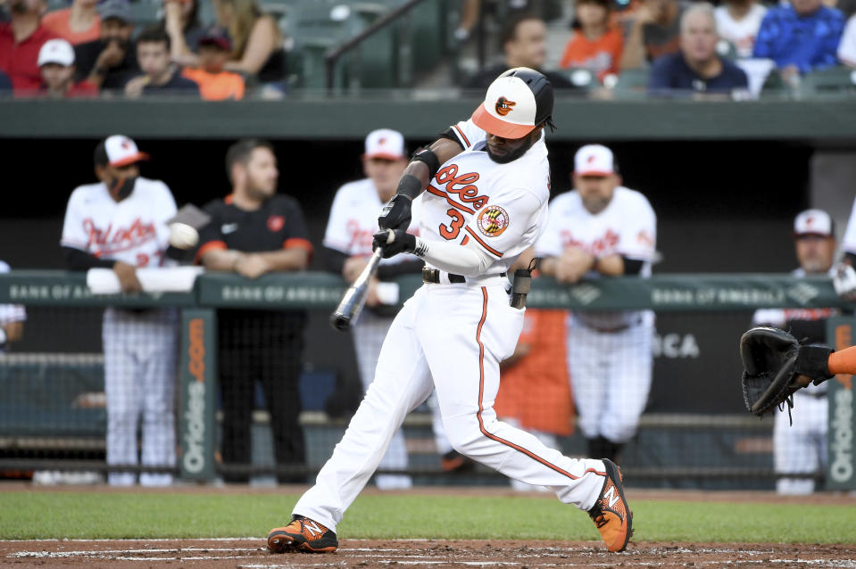 Baltimore Orioles' Cedric Mullins hits a double against the Houston Astros in the first inning of a baseball game, Wednesday, June 23, 2021, in Baltimore. (AP Photo/Will Newton)