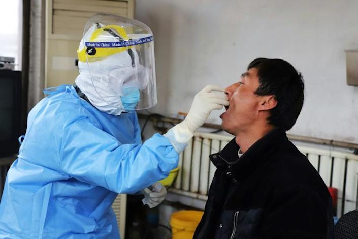 China is struggling to produce enough equipment to deal with the coronavirus outbreak (AFP Photo/STR)