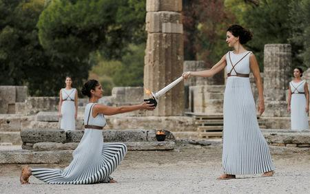 Olympics - Dress Rehearsal - Lighting Ceremony of the Olympic Flame Pyeongchang 2018 - Ancient Olympia, Olympia, Greece - October 23, 2017 Greek actress Katerina Lehou, playing the role of High Priestess, holds a torch during the dress rehearsal for the Olympic flame lighting ceremony for the Pyeongchang 2018 Winter Olympic Games at the site of ancient Olympia in Greece REUTERS/Alkis Konstantinidis