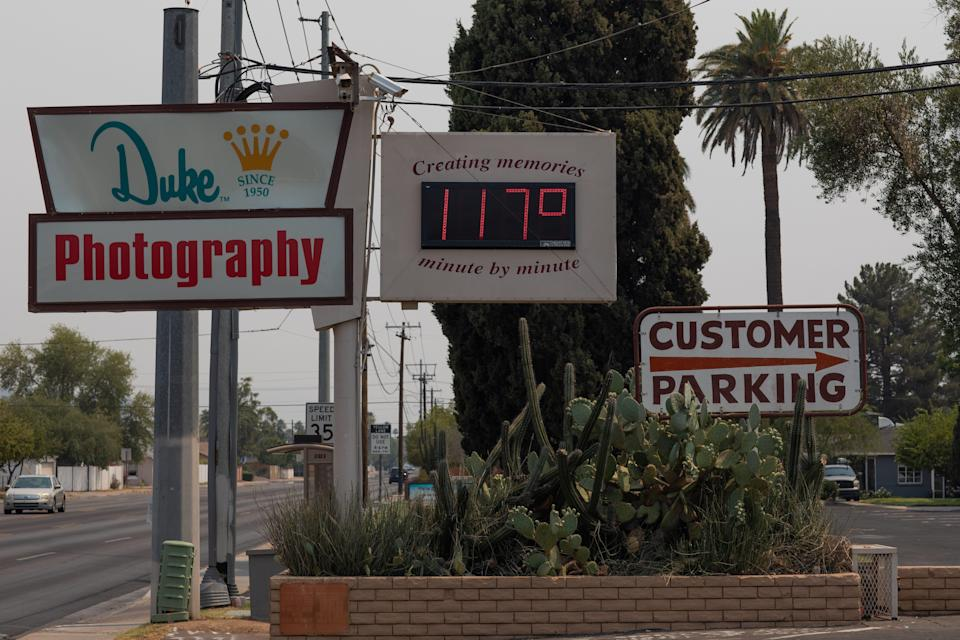 A thermometer sign displays a temperature of 117 degrees Fahrenheit on June 15, 2021 in Phoenix, Arizona.