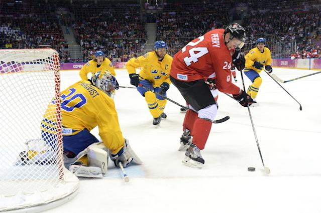 SOCHI, RUSSIA - FEBRUARY 23: Corey Perry #24 of Canada attempts a goal against Henrik Lundqvist #30 of Sweden during the Men's Ice Hockey Gold Medal match on Day 16 of the 2014 Sochi Winter Olympics at Bolshoy Ice Dome on February 23, 2014 in Sochi, Russia. (Photo by Harry How/Getty Images)