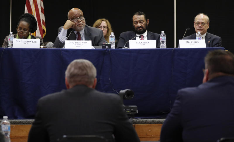 House Homeland Security Committee chairman, U. S. Rep. Bennie Thompson, D-Miss., second from left, questions Jere Miles, Special Agent in Charge of the Homeland Security Investigations for Immigration and Customs Enforcement with the U.S. Department of Homeland Security, right foreground, and Scott County Sheriff Mike Lee, left, foreground, during a field hearing at Tougaloo College in Jackson, Miss., Thursday, Nov. 7, 2019, about the Aug. 7, 2019 ICE raid in Mississippi which resulted in nearly 700 workers being arrested at seven chicken processing plants. (AP Photo/Rogelio V. Solis)