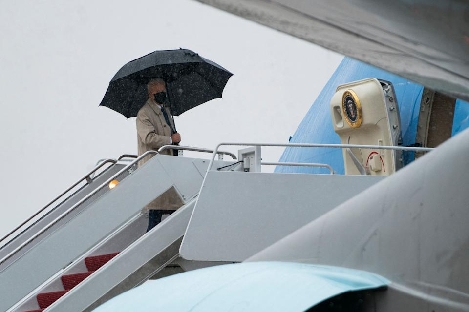 US President Joe Biden boards Air Force One in the rain at Andrews Air Force Base on March 31, 2021 in Maryland. - US President Joe Biden is traveling to Pittsburgh, Pennsylvania to deliver remarks on his economic vision for the future and the Biden-Harris administration's plan to