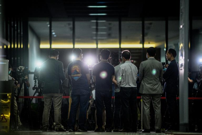 Pro-democracy lawmakers gather for a press conference in Hong Kong late on May 21, 2020, after China's parliament said it will discuss a proposal for a national security law in the semi-autonomous city, a move likely to stoke unrest