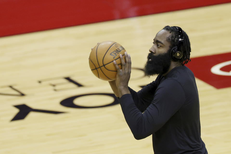 Houston Rockets' James Harden warms up prior to facing the San Antonio Spurs in an NBA basketball game in Houston, Thursday, Dec. 17, 2020. (Carmen Mandato/Pool Photo via AP)