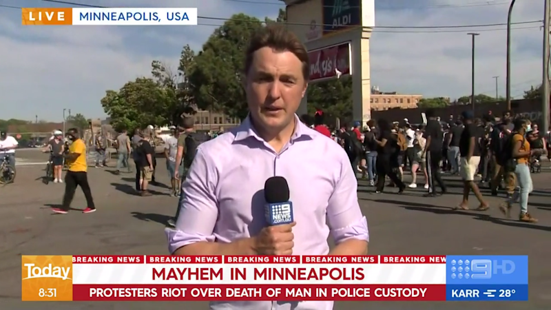 Nine News reporter Tim Arvier at the scene of protests in Minneapolis, USA.
