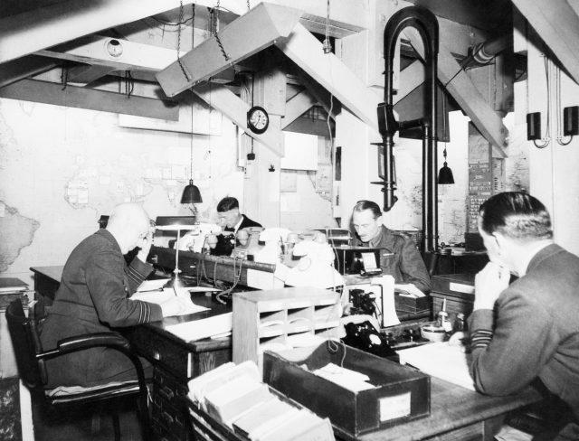 Map Room Officers at work in the Cabinet War Rooms in 1945 (Imperial War Museums/PA)