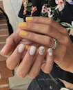 """It wasn't so long ago that we avoided yellow nail polish—something about the hue seems to cause formulas to streak easily. Happily, better formulas abound now, and they're being put to good use at Austin's <a href=""""https://www.instagram.com/p/B0CWjCJA7rs/?igshid=3waujind630v"""" rel=""""nofollow noopener"""" target=""""_blank"""" data-ylk=""""slk:Nail Art House studio"""" class=""""link rapid-noclick-resp"""">Nail Art House studio</a>. Owner Natalia Bychkova loves to pair the cheerful hue with matte print flowers for a delicate effect."""