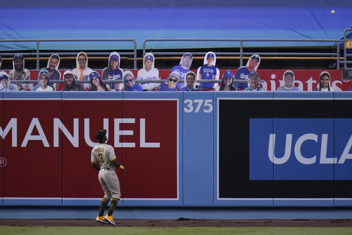 San Diego Padres left fielder Jorge Mateo watches as a ball hit by Los Angeles Dodgers' Mookie Betts clears the wall for a home run during the fourth inning of a baseball game Thursday, Aug. 13, 2020, in Los Angeles. (AP Photo/Jae C. Hong)