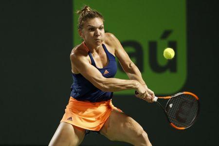 Mar 26, 2017; Miami, FL, USA; Simona Halep of Romania hits a backhand against Anett Kontaveit of Estonia (not pictured) on day six of the 2017 Miami Open at Crandon Park Tennis Center. Geoff Burke-USA TODAY Sports