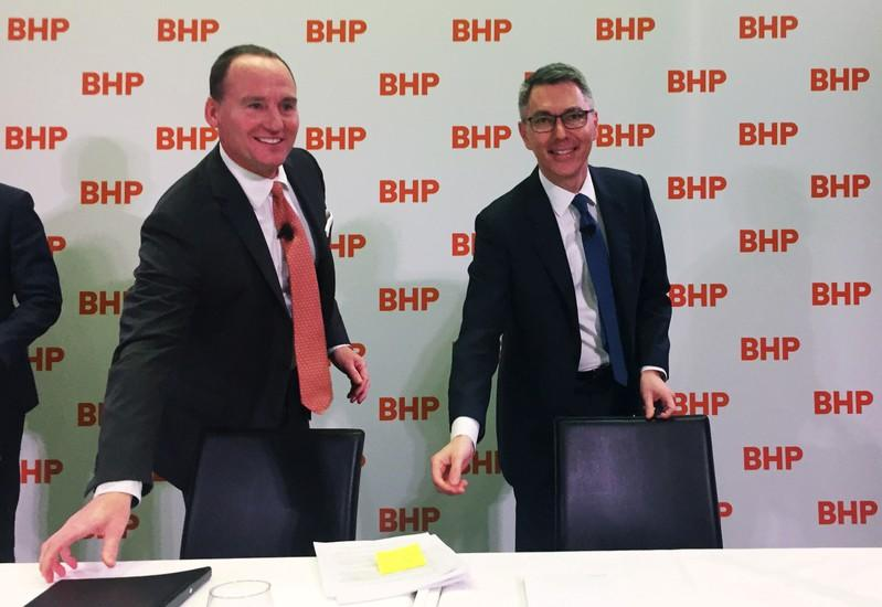BHP Chairman Ken MacKenzie and Mike Henry are seen at a news conference to announce Henry as BHP's new CEO from January 1, 2020, at BHP's Melbourne headquarters