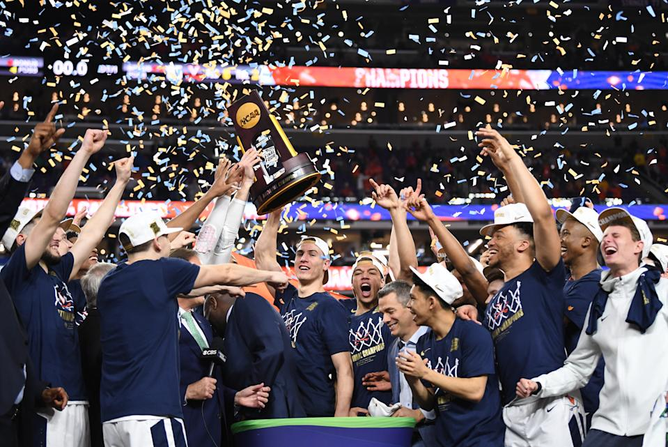 Virginia coach Tony Bennett and his team celebrate after winning the national championship game on April 8, 2019. (Jonathan Newton/Getty Images)