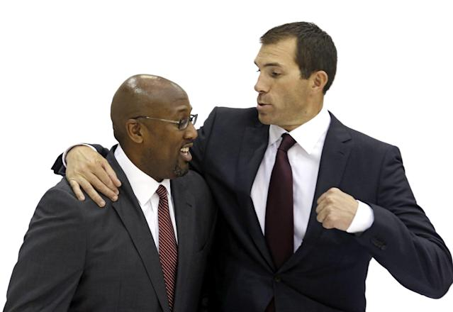 Cleveland Cavaliers general manager Chris Grant, right, pretends to punch head coach Mike Brown during the NBA teams media day Monday, Sept. 30, 2013, in Independence, Ohio. Brown's return as coach has invigorated the Cavaliers, who will open training camp with playoff aspirations and will keep them as long as All-Star point guard Kyrie Irving, forward Anderson Varejao and newly signed center Andrew Bynum can stay healthy. (AP Photo/Tony Dejak)
