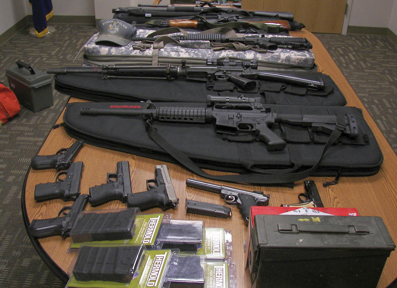 This undated photograph released by the Maine State Police shows weapons gathered from the home and vehicle of Timothy Courtois, of Biddeford, Maine, who was arrested Sunday, July 22, 2012 on charges of having a concealed weapon and speeding on the Maine Turnpike. Found in his car were an assault weapon, four handguns and several boxes of ammunition. A search of his home revealed several additional weapons, including a machine gun, and thousands of rounds of ammunition. Courtois told authorities he was on his way to Derry, N.H., to shoot a former employer. He also said he had attended the Batman movie the previous night. (AP Photo/Maine State Police)