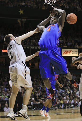 Florida forward Patric Young (4) loses the ball as he drives against Vanderbilt guard Brad Tinsley (1) in the first half of an NCAA college basketball game Tuesday, Feb. 28, 2012, in Nashville, Tenn. (AP Photo/Mark Humphrey)