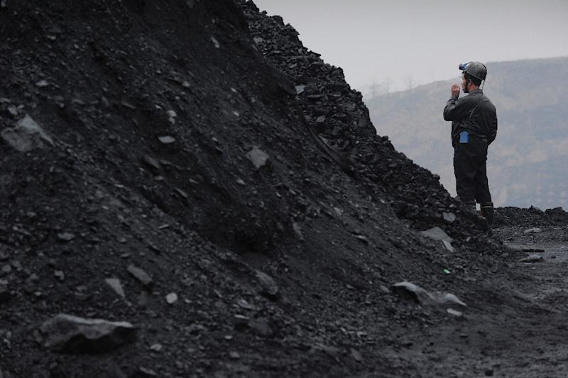 China's coal industry has been particularly hard hit as the country's growth slows (AFP Photo/Peter Parks)