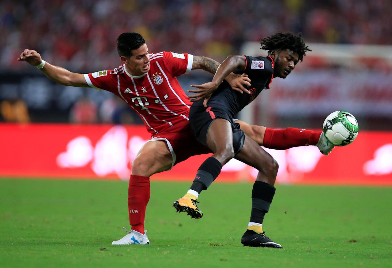 Soccer Football - Bayern Munich vs Arsenal - International Champions Cup - Shanghai, China - July 19, 2017   Bayern Munich's James Rodriguez in action with Arsenal's Ainsley Maitland-Niles   REUTERS/Aly Song
