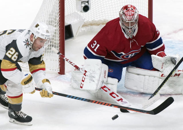 Vegas Golden Knights' Paul Stastny, left, moves in against Montreal Canadiens goaltender Carey Price during second-period NHL hockey game action in Montreal, Saturday, Jan. 18, 2020. (Graham Hughes/The Canadian Press via AP)
