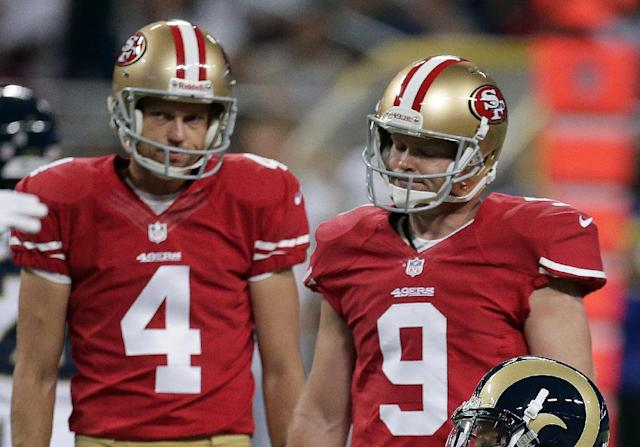 San Francisco 49ers kicker Phil Dawson, right, stands next to Andy Lee after missing a 53-yard field goal attempt during the first quarter of an NFL football game against the St. Louis Rams on Thursday, Sept. 26, 2013, in St. Louis. (AP Photo/Charlie Riedel)
