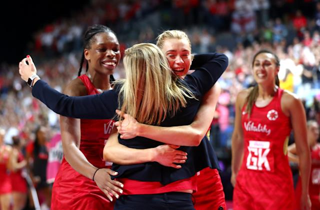 Tracey Neville embraces her players following their win in her final match. (Photo by Chloe Knott - Danehouse/Getty Images)