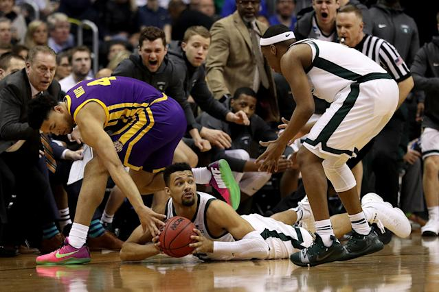 <p>Kenny Goins #25 of the Michigan State Spartans looks to pass the ball from the ground against Skylar Mays #4 of the LSU Tigers during the first half in the East Regional game of the 2019 NCAA Men's Basketball Tournament at Capital One Arena on March 29, 2019 in Washington, DC. (Photo by Patrick Smith/Getty Images) </p>