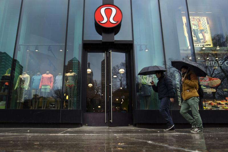 File photo of pedestrians walk past a Lululemon Athletica store in New York
