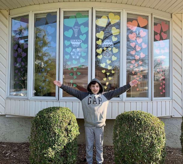 PHOTO: Michael, 9, stands in front of a rainbow he created to spread hope and joy in his Long Island, New York, community amid the coronavirus crisis. (Colleen Casabianca)