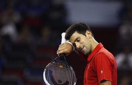 Novak Djokovic of Serbia reacts after winning a point during his men's singles tennis match against Marcel Granollers of Spain at the Shanghai Masters tennis tournament in Shanghai