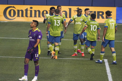 San Jose Earthquakes goalkeeper Daniel Vega, left, stands on the pitch after Seattle Sounders' Joevin Jones, upper left, scored a goal during the second half of an MLS soccer match Thursday, Sept. 10, 2020, in Seattle. The Sounders won 7-1. (AP Photo/Ted S. Warren)